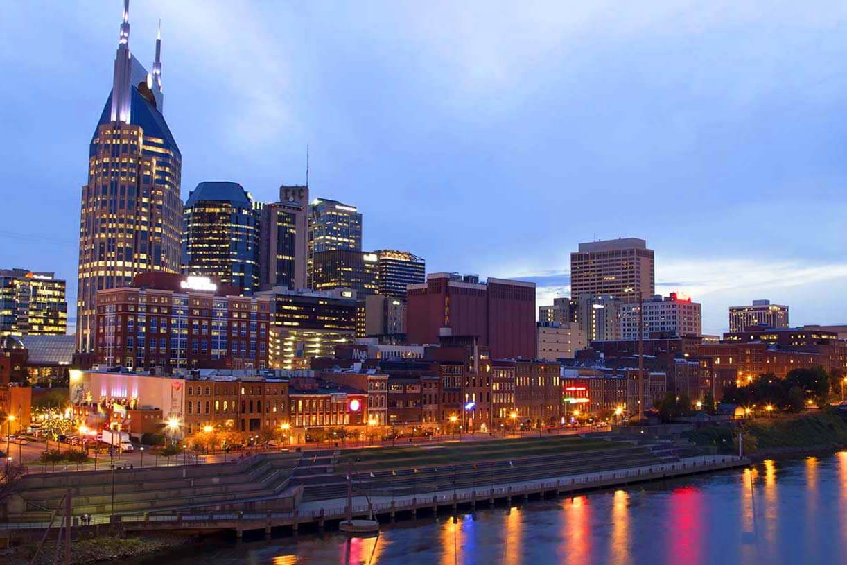 View of Nashville city skyline and river at night