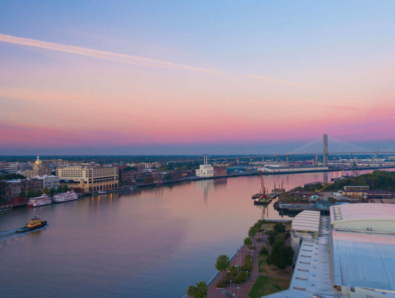 A view of the Savannah River at dusk with the Talmadge Memorial Bridge in the background