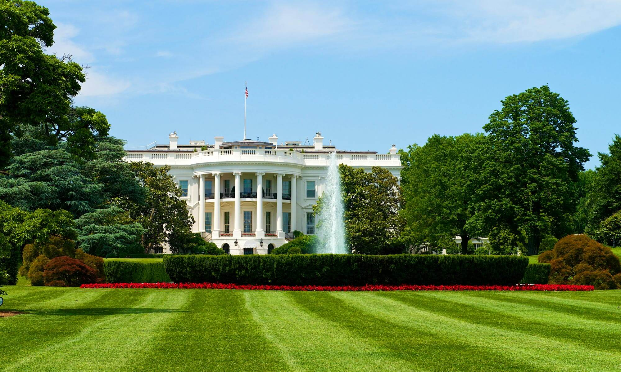 A view of the White House taken from the North Lawn where a fountain can be seen in Washington DC
