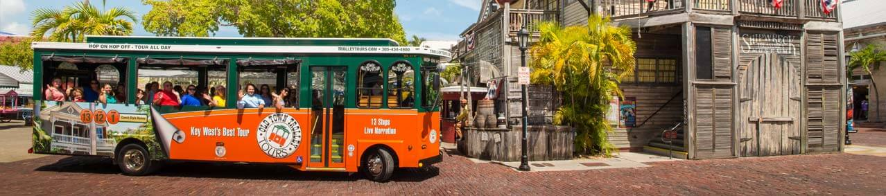 An Old Town Trolley Tour approaching the Shipwreck Museum in Key West, FL