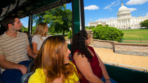 people sightseeing at us capitol building on old town trolley