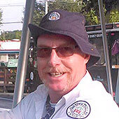 Picture of an Old Town Trolley Tour guide with glasses, a goatee and a floppy hat in St. Augustine, FL
