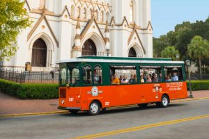 savannah old town trolley parked at cathedral st john baptist