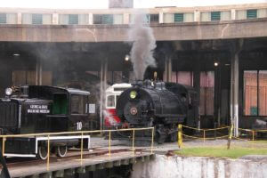 train blowing steam at savannah roundhouse railroad museum
