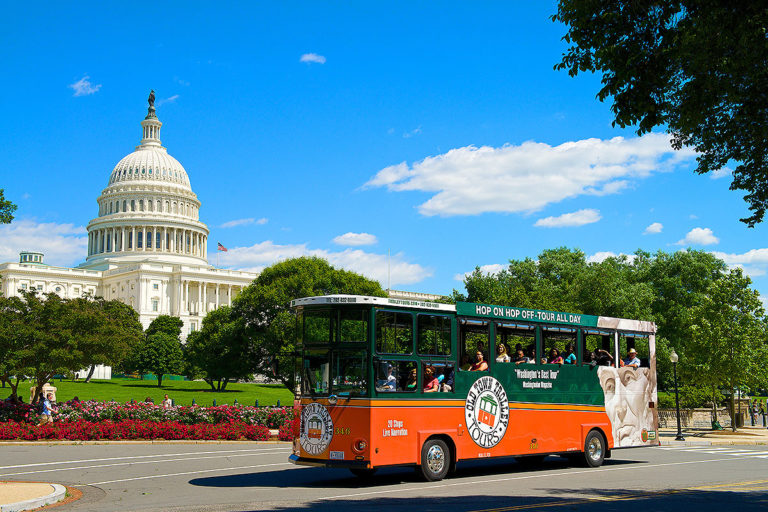old town trolley in Washington DC driving past US Capitol building