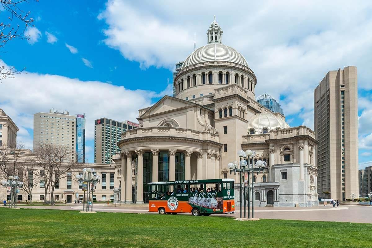 Outside the Christian Science Plaza in Boston where can be seen an Old Town Trolley in front of the Mother Church