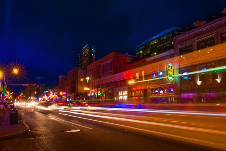 A long exposed night time shot looking down Lower Broadway in Nashville containing trails of color