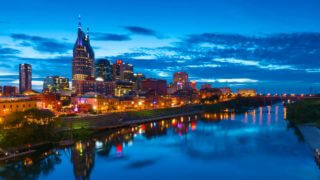 A view of downtown Nashville at night from the John Seigenthaler Pedestrian Bridge