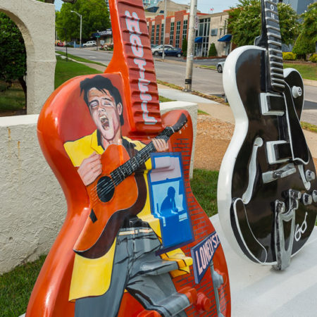 Elvis painting on a guitar