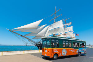 picture of san diego trolley in front of star of india tall ship
