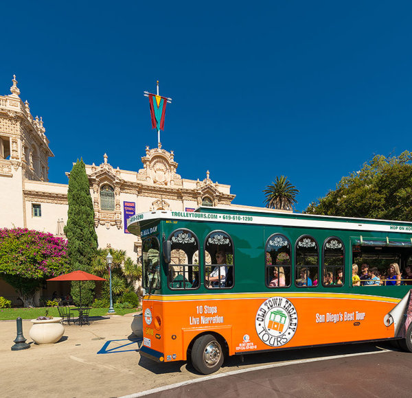 picture of san diego trolley in front of balboa park house of hospitality