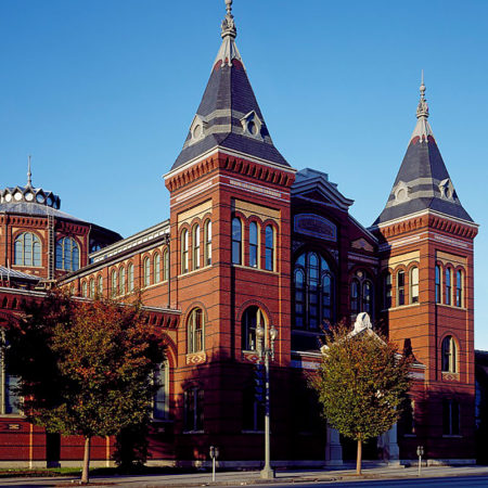 exterior picture of Washington DC arts & Industries building made of bricks, multiple windows and two towers