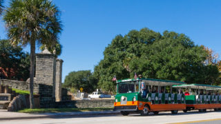 St. Augustine trolley driving past old city gates